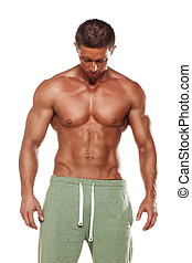 body builder - muscular super-high level handsome man posing...