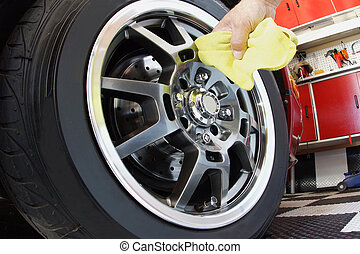 Car maintenance - Hand polishing mag wheel with cloth in...