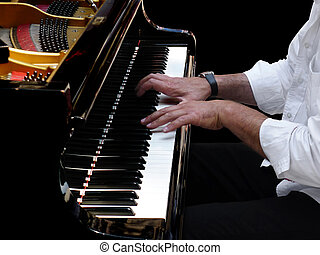 Pianist Plays Jazz Music - Close-up of pianists hands during...