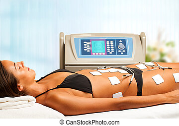 Woman having electrical lymphatic drainage. - Young woman...