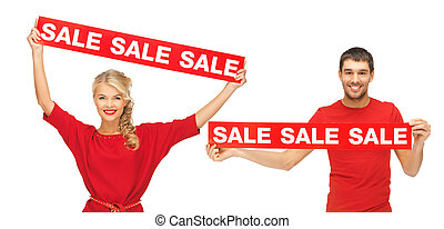 woman and man with red sale signs - shopping and christmas...