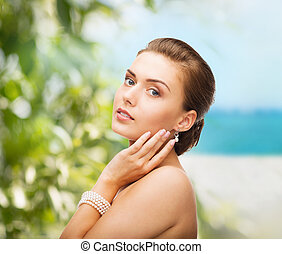 beautiful woman with pearl earrings and bracelet - beauty...