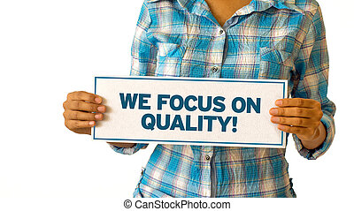 We focus on quality - A woman holding a We focus on quality...