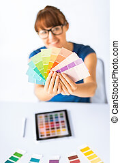 woman showing pantone color samples - interior design,...