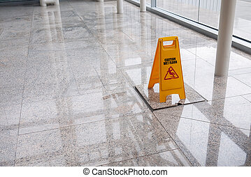 wet floor sign on lobby floor