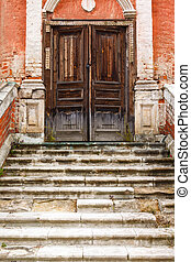 old marble staircases and wooden door poto