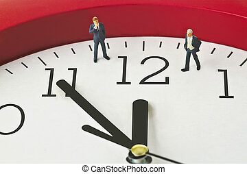 Five to twelve - Figurine on clock face - concept - Five to...