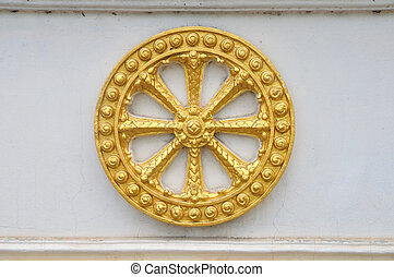 Wheel of law, Dharma on the wall.