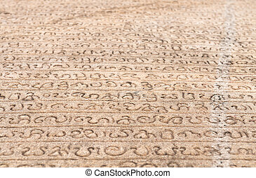 Ancient stone book with Singala characters script...