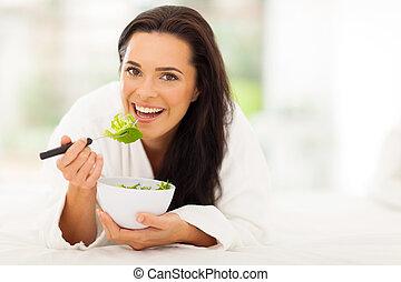 vegetarian eating fresh green salad