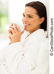 woman on bed drinking morning coffee - relaxed woman on bed...