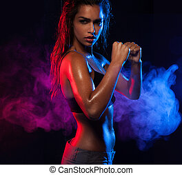 Determined fit sexy woman working out