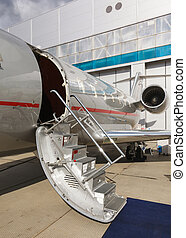 ladder in a private jet and hangar