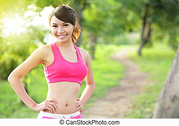 Running woman in park