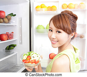 Healthy Eating Concept .Diet. Beautiful Young Woman near the...