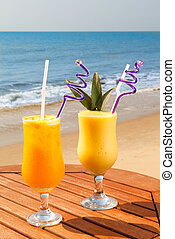pineapple, mango and passion fruit juice - cocktail of...