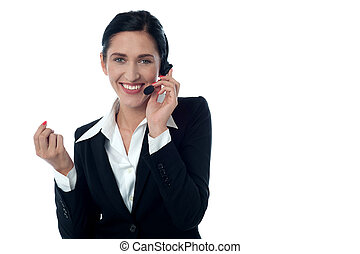 Female customer support executive on call