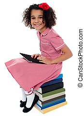Joyous pretty school kid with tablet pc