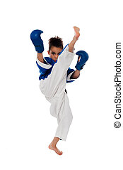Young kid practicing karate - Active little girl practicing...