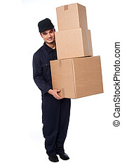 Young courier guy moving boxes - Delivery guy holding stack...