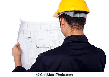 Civil engineer reviewing blueprint - Young male civil...