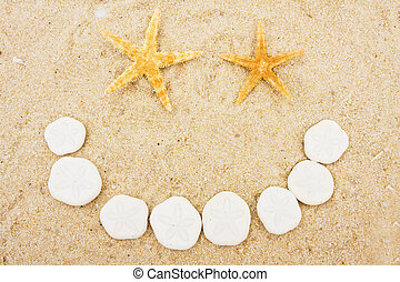 Shell Happy Face - Starfish and sand dollars making a happy...