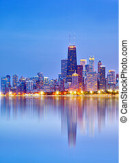City of Chicago USA, sunset colorful panorama skyline of downtown with illuminated business buildings with reflections