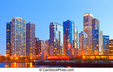 City of Chicago USA,   colorful sunset panorama skyline of downtown with illuminated business buildings