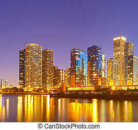 City of Chicago USA,   colorful sunset panorama skyline of downtown with illuminated business buildings with reflections