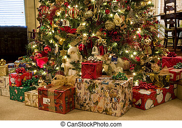 Presents Under Tree - A nicely decorated christmas tree with...