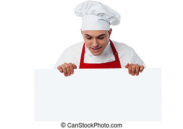 Place your restaurant ad here - Handsome male chef behind...