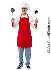 Chef holding kitchen essentials - Experienced chef...