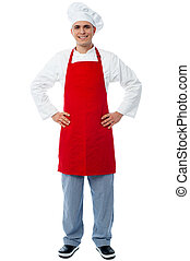 Experienced male chef posing casual - Young male chef posing...