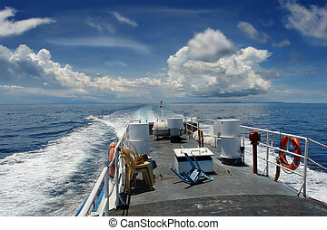 Fast craft under clouds - Fast craft ferry boat speeding and...