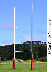 Sports - Rugby - Rugby ball passing through Goal posts for...