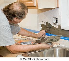 Tile Setter Applying Mortar