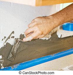 Applying Morter to Wall - Tile setter applies thin set...