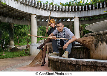 Punk Asian couple with broom - Teenage punk or emo Asian...