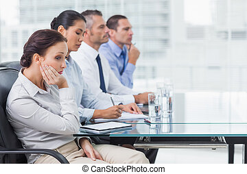 Businesswoman getting bored while attending presentation -...