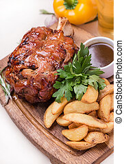 hot backed ham with garnish on wooden board - hot eisben...