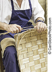 Craftsman making baskets with cut wood worker and artist