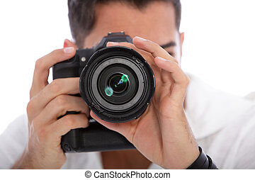 Male photographer taking a photograph