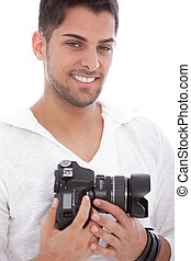 Smiling man with a digital camera - Smiling good looking man...