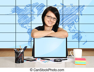 woman with note pad sitting in office