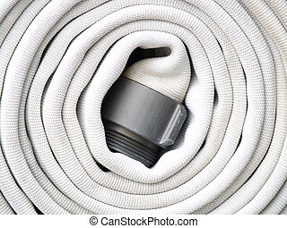 Hose Coil - A white firehose coiled and ready to go in case...