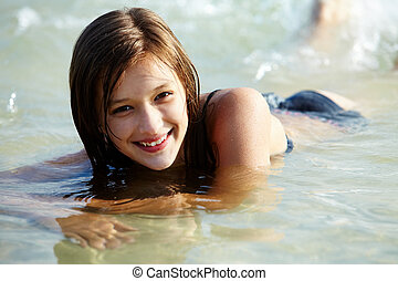 Swimming girl - Portrait of wet attractive girl in the water