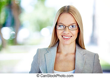 Business lady - Portrait of a smiling young lady looking at...