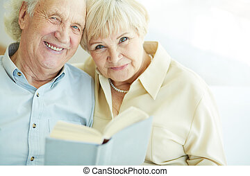 Happy seniors - Portrait of a candid senior couple reading...