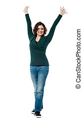 Jubilant woman with raised arms cel - Full length portrait...