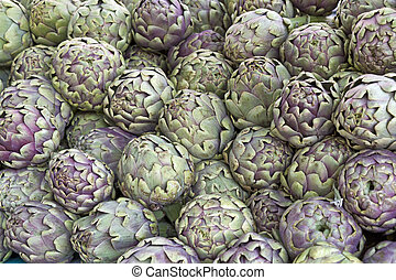 Fresh artichokes on display, as background - Fresh...